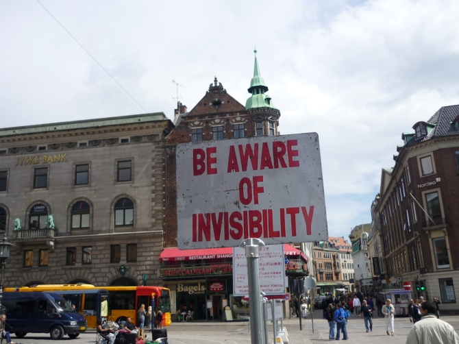 sign saying be aware of invisibility